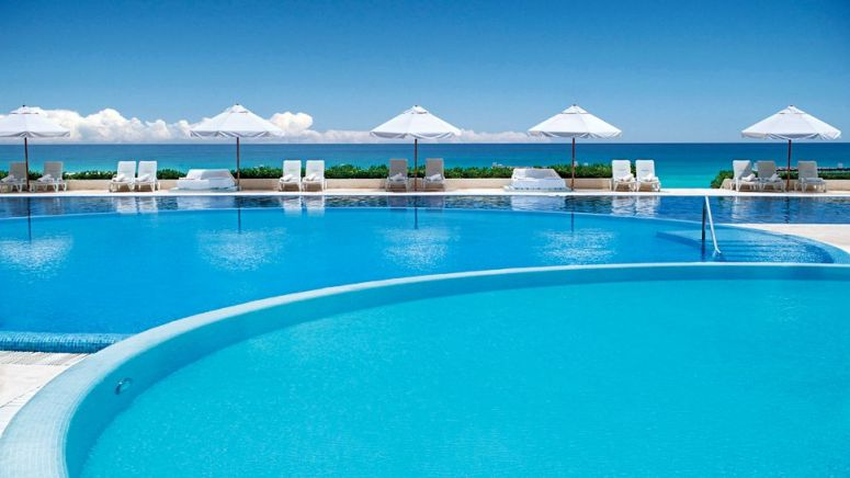 007257-16-exterior-day-pool-sea-view